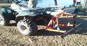 Polaris 4x4 ATV with T-Point Lift three point hitch and Rake